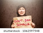 muslim girl in black hijab... | Shutterstock . vector #1062597548