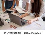 business team analyzing... | Shutterstock . vector #1062601223