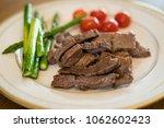 steak and asparagus | Shutterstock . vector #1062602423