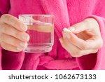 girl in pink bathrobe. hands... | Shutterstock . vector #1062673133