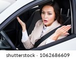 young pretty woman driver... | Shutterstock . vector #1062686609