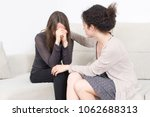 woman comforting a female friend | Shutterstock . vector #1062688313