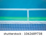 tennis court with net background | Shutterstock . vector #1062689738