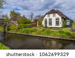 typical dutch village giethoorn ... | Shutterstock . vector #1062699329
