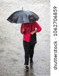 a woman runs in the rainy... | Shutterstock . vector #1062706859