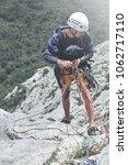 man rock climber climbed on the ... | Shutterstock . vector #1062717110