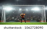 soccer goalkeeper in action on... | Shutterstock . vector #1062728090