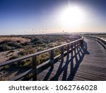 wooden pier with kite surfers... | Shutterstock . vector #1062766028