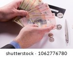 an holding romanian banknotes ... | Shutterstock . vector #1062776780