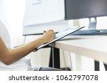 business women reviewing data... | Shutterstock . vector #1062797078