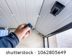 garage door pvc. hand use... | Shutterstock . vector #1062805649