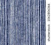 abstract noisy striped indigo... | Shutterstock . vector #1062806366