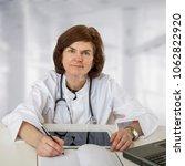 female doctor at the desk  | Shutterstock . vector #1062822920
