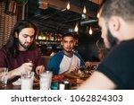 young arabian men having... | Shutterstock . vector #1062824303