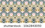 ikat geometric folklore... | Shutterstock .eps vector #1062843050