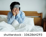 a woman waking up | Shutterstock . vector #1062864293
