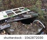 old white door lies in the... | Shutterstock . vector #1062872030