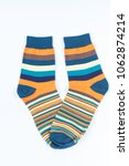 Small photo of A pair of striped socks. Stripes color: mustard, turquoise, blue and white . April of 2018.