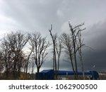 blue gray dark cloudy sky. bare ... | Shutterstock . vector #1062900500