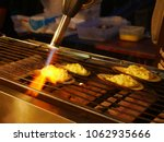 chef make a food with cooking... | Shutterstock . vector #1062935666