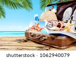 summer suitcase on beach and... | Shutterstock . vector #1062940079