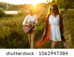 lovers in nature. young... | Shutterstock . vector #1062947384