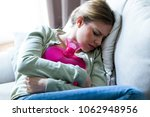 shot of unhealthy young woman...   Shutterstock . vector #1062948956