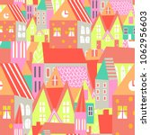 cute houses seamless pattern.... | Shutterstock .eps vector #1062956603