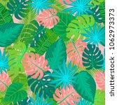 green tropical leaves pattern... | Shutterstock .eps vector #1062973373