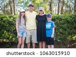 young family portrait all... | Shutterstock . vector #1063015910