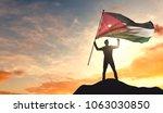 jordan flag being waved by a... | Shutterstock . vector #1063030850