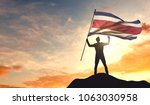 costa rica flag being waved by... | Shutterstock . vector #1063030958