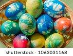 multicolored easter eggs.... | Shutterstock . vector #1063031168