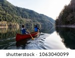 Couple Friends Canoeing On A...
