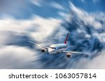 modern airplane mith motion... | Shutterstock . vector #1063057814