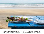 delicious grilled fish on blue... | Shutterstock . vector #1063064966
