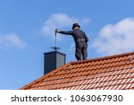 chimney sweep cleaning a... | Shutterstock . vector #1063067930