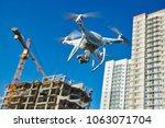 drone survellance over... | Shutterstock . vector #1063071704