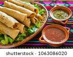 flautas de pollo  chicken tacos ...   Shutterstock . vector #1063086020