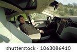 businessman sleeping behind... | Shutterstock . vector #1063086410