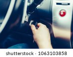 the driver of the man gets a... | Shutterstock . vector #1063103858