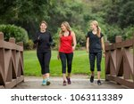 Stock photo group of women in their s walking together in the outdoors cute blond and fit women in their mid 1063113389