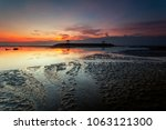 sanur  is a coastal stretch of...   Shutterstock . vector #1063121300