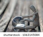 Wooden Mannequin Sitting On A...