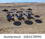 sunshade parasol on a tropical  ... | Shutterstock . vector #1063178990