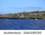 Pacific ocean view of shore line, roof tops and trees near Lanai City, Hawaii