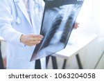 woman doctor looking at x ray... | Shutterstock . vector #1063204058