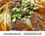 braised beef in broth with...   Shutterstock . vector #1063206110