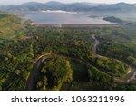 aerial view of rural village... | Shutterstock . vector #1063211996
