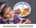 indian school children eat... | Shutterstock . vector #1063220180